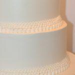 white buttercream graduated pearl border