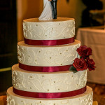 Apple red and gold scrolls roses buttercream wedding cake