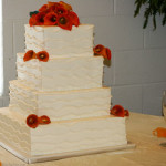 Burnt orange calla lillies textured wave wedding cake