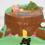 Fairy and dragon tree stump birthday buttercream cake