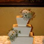 Italian stucco textured taper square wedding cake