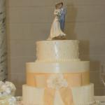 Peach bow vertical texture wedding cake