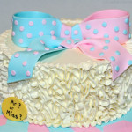 Pink and blue gender reveal ruffles cake