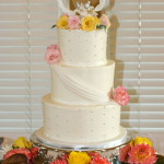 Pink and yellow roses wedding cake