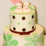 Pink baby booties twin baby shower cake