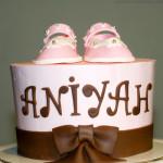 Pink booties baby shower cake