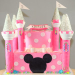Pink disney princess castle birthday cake