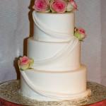 Pink roses draping wedding cake