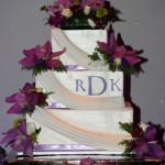 Purple orchids square monogram buttercream draping wedding cake