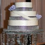 Purple rhinestone engagement buttercream draping cake