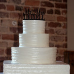 horizontal textured buttercream cake white Mr and Mrs topper