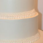 white buttercream graduated pearl border