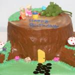 Fairy and dragon tree stump birthday buttercream cake