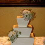 Italian stucco textured taper square wedding cake