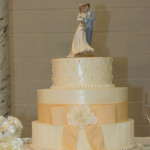 Peach bow vertical texture wedding cake