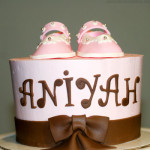 Pink booties baby shower cake