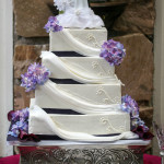 Purple and white drape wedding cake