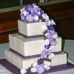Purple roses cascade wedding cake