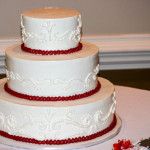 Red and white scrolls wedding cake