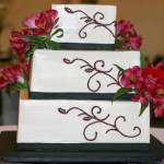 Red scrolls square buttercream wedding cake