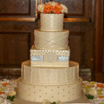 Tangerine orange and silver monogram round and square wedding cake