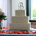 white buttercream quilting with overpiping tridots monogram topper rhinestone bling